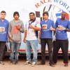 """""""فريق عالم السباق"""" يدرب طلاب المعهد المهني على تجهيز سيارات الراليات"""