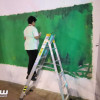 اصغر تشكيلي مشارك في جدارية الوطن بدومة الجندل يلفت الأنظار