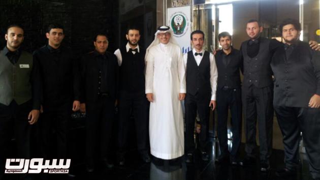 المنتخب السعودي المشارك في البطولة يتوسطهم مدير المنتخب