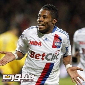 Lyon's Michel Bastos, of Brazil, celebrates after scoring against Sochaux during their French League One soccer match at Gerland stadium, in Lyon, central France, Saturday, Oct. 30, 2010. (AP Photo/Laurent Cipriani)