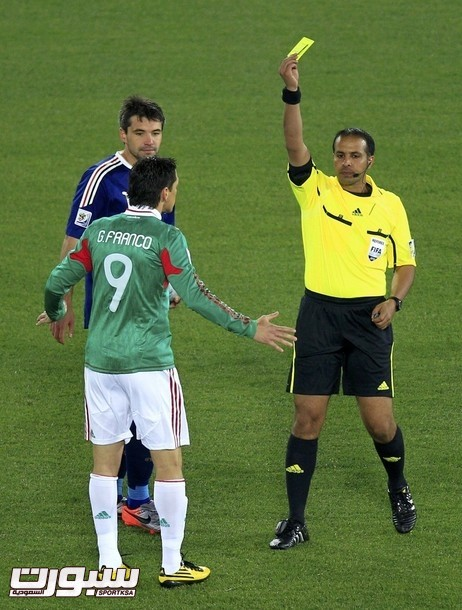 Referee Al Ghamdi of Saudi Arabia shows yellow card to Mexico's Franco during a 2010 World Cup soccer match against France at Peter Mokaba stadium in Polokwane