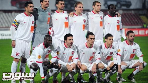 Dinamo Bucharest players pose prior to t
