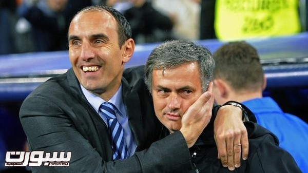 Dinamo Zagreb's coach Krunoslav Jurcic and his Real Madrid counterpart Jose Mourinho embrace before their Champions League Group D soccer match at Santiago Bernabeu stadium in Madrid