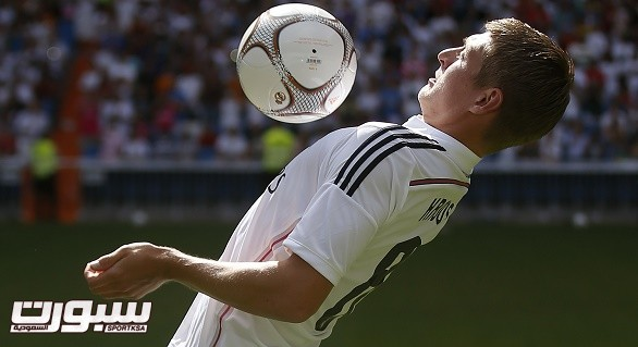 New Real Madrid midfielder Kroos of Germany controls the ball during his presentation at Santiago Bernabeu stadium in Madrid
