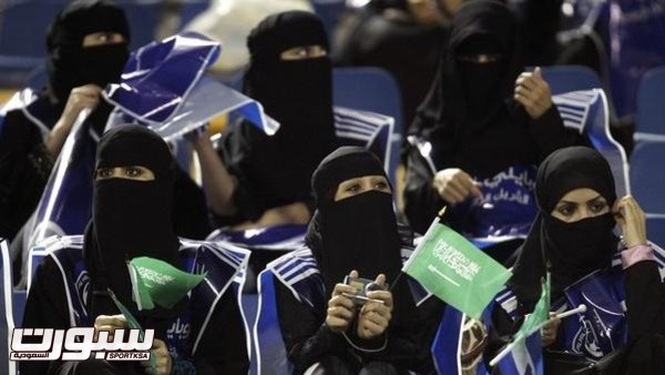 Fans of Saudi Arabia's Al-Hilal cheer during their AFC Champions League soccer match against Qatar's Al-Gharafa