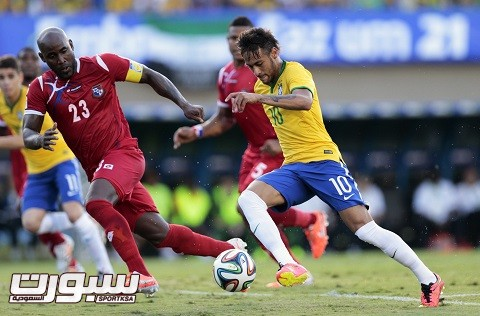 Neymar of Brazil challenges Baloy of Panama during an international friendly soccer match, in Goiania