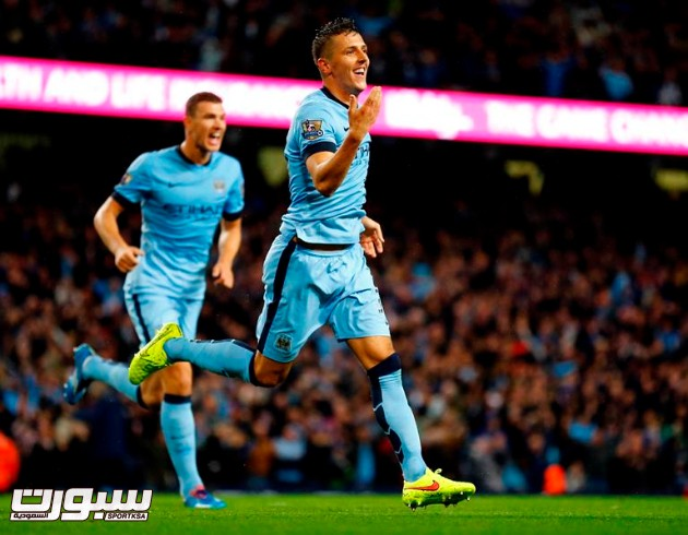 """Manchester City's Stevan Jovetic (front) celebrates after scoring a goal against Liverpool during their English Premier League soccer match at the Etihad stadium in Manchester, northern England August 25, 2014.  REUTERS/Darren Staples  (BRITAIN - Tags: SPORT SOCCER) FOR EDITORIAL USE ONLY. NOT FOR SALE FOR MARKETING OR ADVERTISING CAMPAIGNS. NO USE WITH UNAUTHORIZED AUDIO, VIDEO, DATA, FIXTURE LISTS, CLUB/LEAGUE LOGOS OR """"LIVE"""" SERVICES. ONLINE IN-MATCH USE LIMITED TO 45 IMAGES, NO VIDEO EMULATION. NO USE IN BETTING, GAMES OR SINGLE CLUB/LEAGUE/PLAYER PUBLICATIONS"""