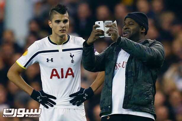 A-spectator-runs-onto-the-pitch-and-takes-a-selfie-of-himself