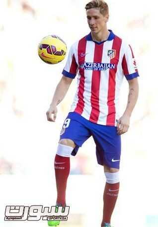 صور استقبال جماهير أتليلتكو مدريد للاعب توريس