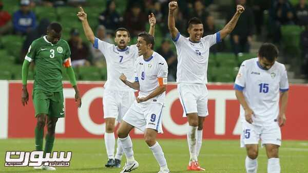 Uzbekistan's players celebrate after winning their Asian Cup Group B soccer match against Saudi Arabia at the Rectangular stadium in Melbourne