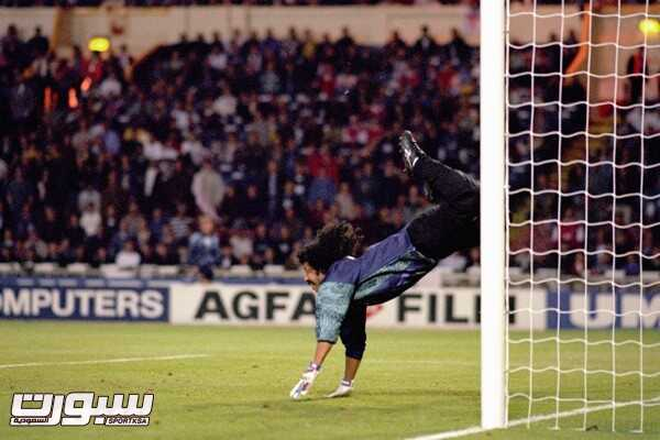 Rene Higuita, Colombia, clears the ball with a backward overhead kick against England