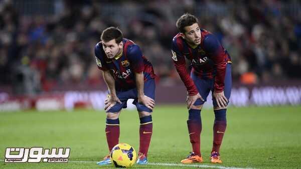 FC Barcelona's Lionel Messi, from Argentina, left, and Jordi Alba look on during a Spanish La Liga soccer match against Malaga at the Camp Nou stadium in Barcelona, Spain, Sunday Jan. 26, 2014. (AP Photo/Manu Fernandez)