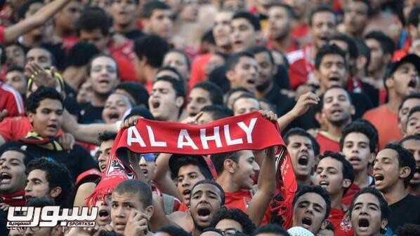 Al-Ahly fans cheer prior to their African Champions League second leg final, Egypt's Al-Ahly versus South Africa's Orlando Pirates in Cairo, on November 10, 2013. The sides drew 1-1 in the first-leg of the CAF Champions League Final on November 2 at Orlando Stadium in Johannesburg.  AFP PHOTO / KHALED DESOUKI        (Photo credit should read KHALED DESOUKI/AFP/Getty Images)