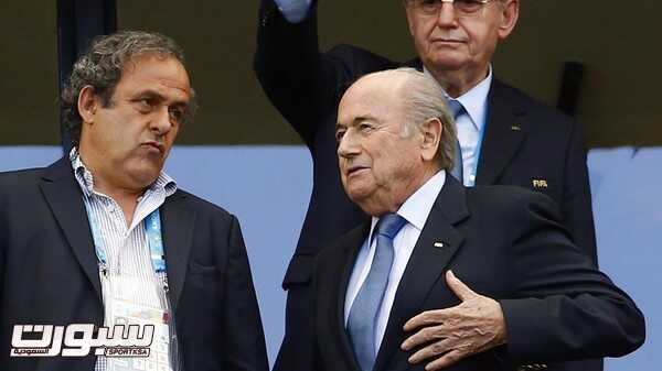 FIFA President Sepp Blatter speaks with UEFA President Michel Platini (L) before the 2014 World Cup Group G soccer match between Germany and Portugal at the Fonte Nova arena in Salvador June 16, 2014.      REUTERS/Darren Staples (BRAZIL  - Tags: SOCCER SPORT WORLD CUP)