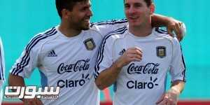 Argentina's national football forward Lionel Messi (R) talks with teammate forward Sergio Aguero during a training session in Ezeiza, Buenos Aires, on September 6, 2013. Argentina will face Paraguay on September 10 in Asuncion in a Brazil 2014 FIFA World Cup South American qualifier match.   AFP PHOTO / DANIEL GARCIA        (Photo credit should read DANIEL GARCIA/AFP/Getty Images)
