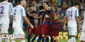 Barcelona's players celebrate a goal against Malaga during their Spanish first division soccer match at Camp Nou stadium in Barcelona, Spain, August 29, 2015. REUTERS/Albert Gea