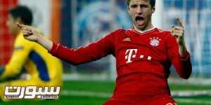 Thomas Mueller of Bayern Munich celebrates a goal against FC Basel during their Champions League round-of-16 second leg match in Munich March 13, 2012.   REUTERS/Michael Dalder(GERMANY - Tags: SPORT SOCCER)