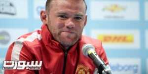 Manchester United's Wayne Rooney answers questions at a news conference in Goteborg August 7, 2012. Manchester United will play Barcelona in a friendly soccer match on Wednesday.   REUTERS/Patrick Sorquist/Scanpix (SWEDEN - Tags: SPORT SOCCER) THIS IMAGE HAS BEEN SUPPLIED BY A THIRD PARTY. IT IS DISTRIBUTED, EXACTLY AS RECEIVED BY REUTERS, AS A SERVICE TO CLIENTS. SWEDEN OUT. NO COMMERCIAL OR EDITORIAL SALES IN SWEDEN