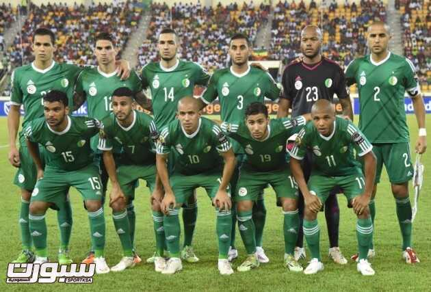 Algeria's players line up prior to the 2015 African Cup of Nations group C football match between Senegal and Algeria, on January 27, 2015 in Malabo. (From LtoR, upper to lower row) Algeria's defender Aissa Mandi, Algeria's defender Carl Medjani, Algeria's midfielder Nabil Bentaleb, Algeria's defender Faouzi Ghoulam, Algeria's goalkeeper Rais Mbolhi, Algeria's defender Madjid Bougherra, Algeria's forward El Arabi Soudani, Algeria's forward Riyad Mahrez, Algeria's midfielder Sofiane Feghouli, Algeria's midfielder Saphir Taider and Algeria's midfielder Yacine Brahimi.AFP PHOTO / ISSOUF SANOGO