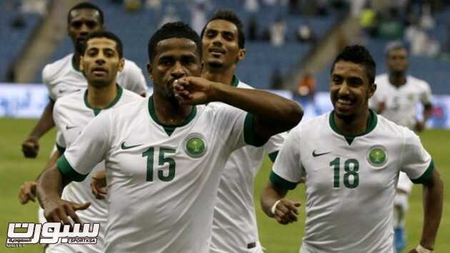 Saudi player Nasser al-Shamrani (C) celebrates with teammates after scoring a goal against Bahrain during their Gulf Cup Group A football match at the King Fahad International Stadium in Riyadh on November 16, 2014. AFP PHOTO/KARIM SAHIB        (Photo credit should read KARIM SAHIB/AFP/Getty Images)