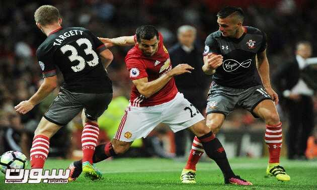 epa05500448 Manchester United's Henrikh Mkhitaryan (C) in action against Southampton's Matt Targett (L) and Southampton's Dusan Tadic during the English Premier League soccer match between Manchester United and Southampton at Old Trafford, Manchester, Britain, 19 August 2016.  EPA/PETER POWELL No use with unauthorized audio, video, data, fixture lists, club/league logos or 'live' services. Online in-match use limited to 75 images, no video emulation. No use in betting, games or single club/league/player publications   EDITORIAL USE ONLY  EDITORIAL USE ONLY