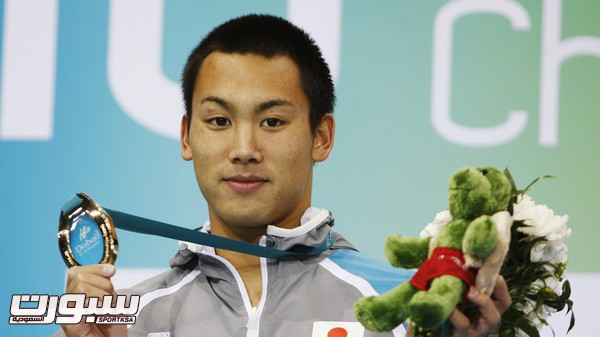 File photo of gold medallist Tomita of Japan posing after the men's 200m breaststroke final at the 10th FINA World Swimming Championships (25m) in Dubai