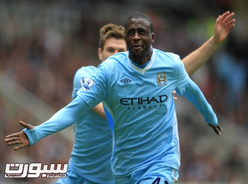 Manchester City's Yaya Toure celebrates scoring the first goal