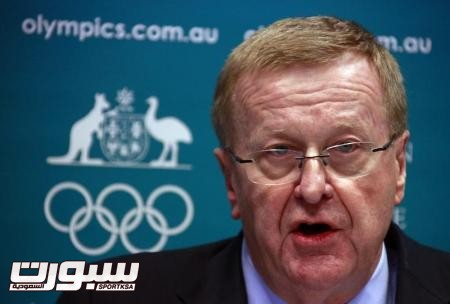 John Coates announces the findings of a probe into the conduct of Australia's swimming team members in the run-up to the 2012 London Games, at a media conference in Sydney