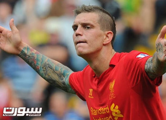 Liverpool's Daniel Agger protests